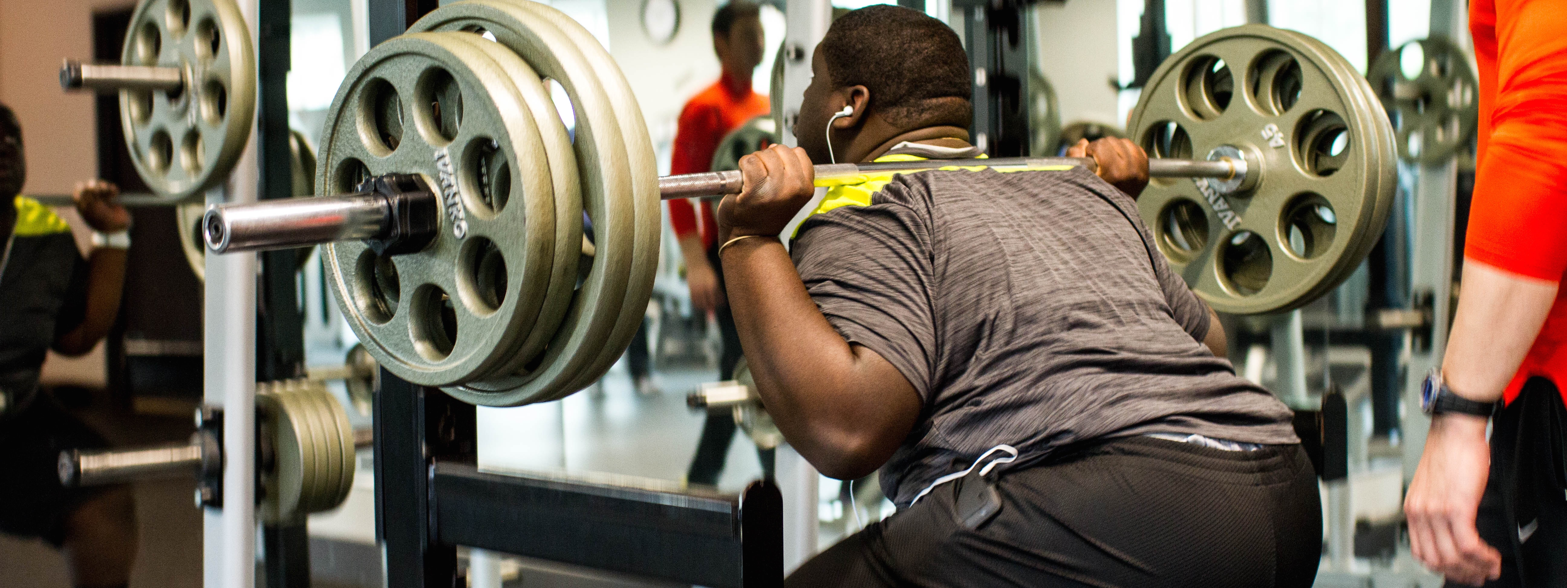 Weight training with a personal trainer at Core Results