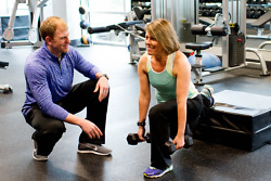 A personal trainer working with a client